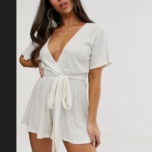 Playsuit with tie waist in white soft rib